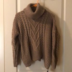 Light brown turtleneck sweater